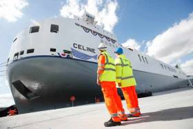 Port workers looking on to the MV Celine, the world's largest short sea Ro-Ro ship owned by CLdN, christened at Dublin Port