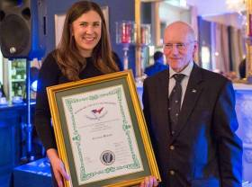 Outgoing National Yacht Club Commodore Larry Power with NYC member Annalise Murphy at the awards night. Scroll down for photo gallery