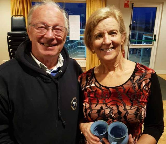 DMYC Frostbite mug winner Louise McKenna with club Commodore Frank Guilfoyle