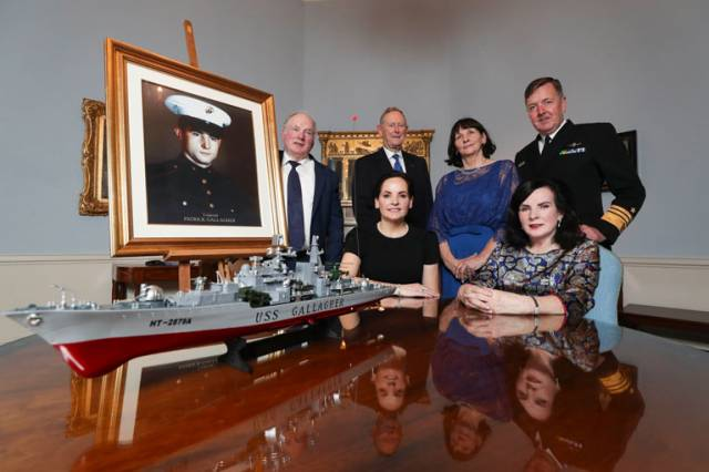 Pictured are siblings of Corporal Patrick 'Bob' Gallagher, Peter, Pauline, Theresa and Rosemary  with a portrait of their brother Corporal Patrick Gallagher and replica of USS Gallagher at the reception in recognition of naming of the ship USS Patrick Gallagher hosted by Lord Mayor of Dublin Nial Ring