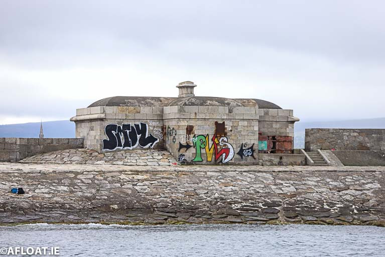 First sight of Dun Laoghaire from the sea: A shoreward view of vacant buildings are blighted by graffitii on Dun Laoghaire's West Pier. The council says graffiti poses a significant problem throughout the Dun Laoghaire area