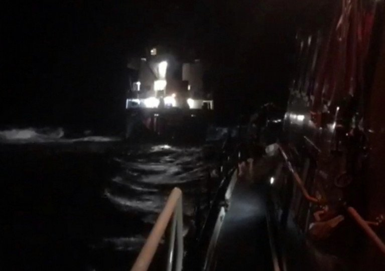 Portree lifeboat approaches the grounded cargo ship MV Kaami