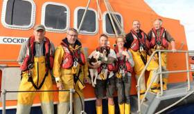 Courmacsherry's lifeboat crew with the rescued setter