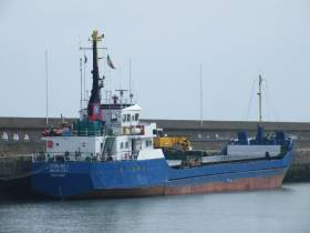 The Belize City registered Burhou I having discharged round timber (logs) from Scotland, was detained in Wicklow Port and is seen at the harbour's East Pier on St. Patrick's Day