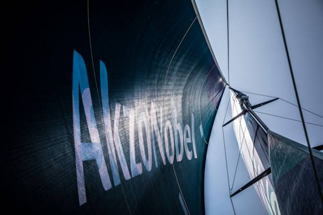 Team AkzoNobel's Nicolai Sehested climbs the rig to make checks and look for wind