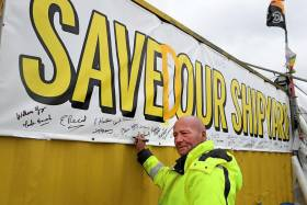 Workers return to the Harland and Wolff shipyard after a buyer was found to save the Belfast shipyard. ABOVE: Campaign banner with the slogan 'Save Our Shipyard' was recently revised with insertion of the letter 'D' to reflect the current changed fortunes of the iconic shipyard located in the east of the port estate.