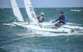Edward Rice of Royal Cork Yacht Club to leeward and closest to camera and David Hillmyer of Sarasota Sailing Squadron power reaching on a blustery Dublin Bay in the first day of the Laser Master Championships