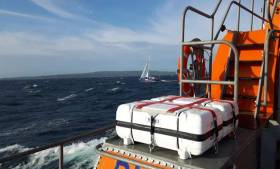 The lifeboat guided the yacht alongside the pier in Kilronan Harbour