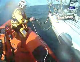Union Hall RNLI attaches a towline to the stricken yacht