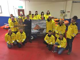 Geoff Johnston presents his painting to Larne RNLI coxswain Frank Healey