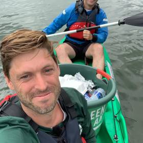 Danish GreenKayak joins Dublin's City Kayaking to offer free trips to pick up plastic. Above: Tobias Weber-Anderson of GreenKayak on the Liffey with bucket full of litter.