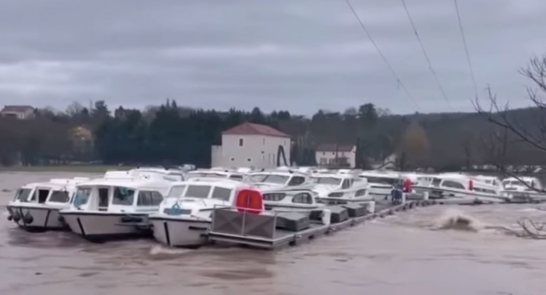 Cruisers are dragged en masse from their moorings in the raging floodwaters