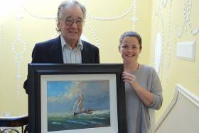 Artist Brian Byrnes and Maedhbh Murphy, archivist of the Royal College of Surgeons in Ireland, with the artist's new painting envisaging how Sir Thomas Myles' Chotah, one of the Irish gun-running vessels of 1914, might have looked with a steam-driven auxiliary engine fitted. Sir Thomas Myles was President of the RCSI from 1900 to 1902