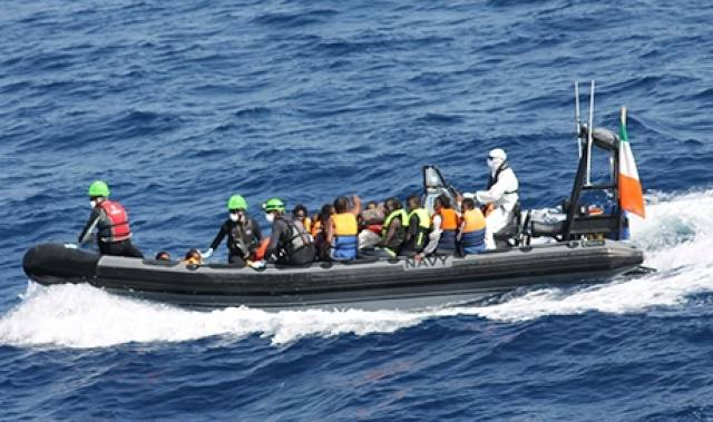 A rigid inflatable boat (RIB) from LE Samuel Beckett with rescued migrants on board