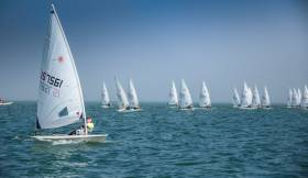 Royal Cork's Chris Bateman (157561) works the right hand side of the course in the final race of the Laser Radial division of the Volvo Youth Sailing Nationals on Dublin Bay. Royal Cork sailors performed well at the event, scroll down for more.