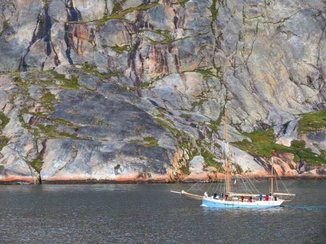 Leaving Greenland…..Ilen under Paddy Barry's command seen recently heading eastward through Prinz Christian Sund, the awesomely steep but very convenient passage inside Greenland's most southerly headland of Cape Farewell. The colours leaching from some of those cliffside rocks suggest that this rugged environment might hold impressive reserves of valuable minerals, making it one very desirable piece of real estate………..if it were for sale.