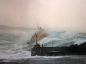 Is this the greatest lifeboat photo ever taken? Ian Watson's iconic image of the Portrush Lifeboat putting to sea on February 13th 1989. Photo Ian Watson