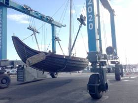 A Viking longship is lifted into the water on the MGM Boatyard hoist at Dun Laoghaire's Coal Harbour this morning