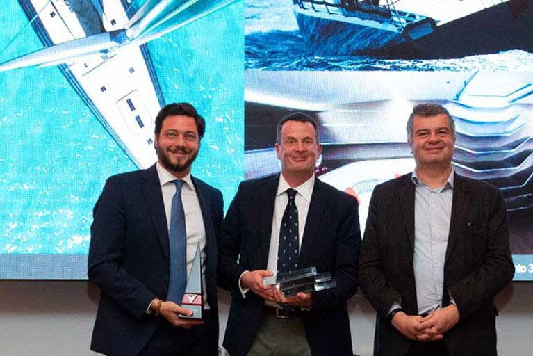 Mark Mills of Mills Design (pictured centre) accepts his award in Monaco