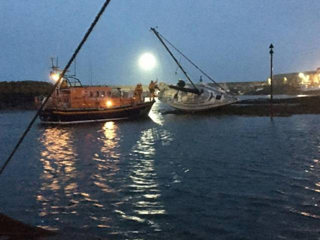Newcastle RNLI assisting the grounded yacht at Ardglass Marina in the early hours of Wednesday morning