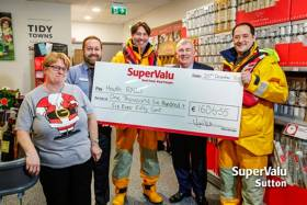 Cora Walsh, Neville Raethorne (manager of SuperValu Sutton), Ian Sheridan, Aidan Cooney and Howth RNLI coxswain Fred Connolly after the trolley dash on Tuesday 20 December