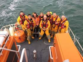 Comedian PJ Gallagher with Dun Laoghaire RNLI volunteers