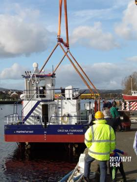 Newbuild Croi na Farraige, a 17.5m salmon farm harvesting vessel is lowered into the River Avoca in Arklow