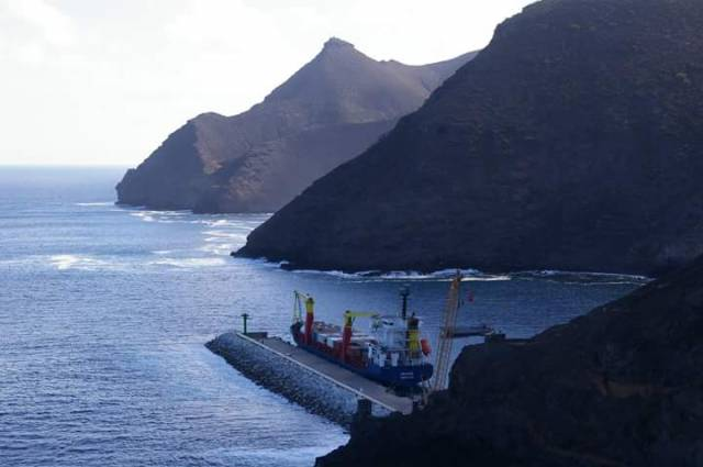 Cargoship MV Helena with the dramatic backdrop of the mountainous coast of St. Helena Island, located in the South Atlantic Ocean. Helena is seen docked in Ropert's Bay on the first day of arrival (7 March) following a delayed debut on the new freight service from South Africa.