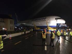 The Boeing 767 is transported across the road from the beach at Enniscrone to the new glamping site