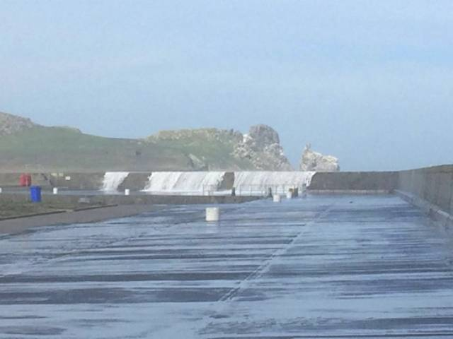 Waves breaking over Howth's East Pier are a danger to walkers