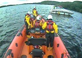 Carrybridge RNLI approaching the grounded cruiser on Upper Lough Erne