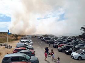Smoke from the dune fire blows over the car park at Curracloe beach this afternoon