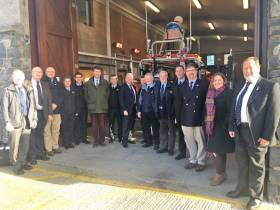 Sir Tim Laurence and fellow RNLI officials with Bangor lifeboat station volunteers