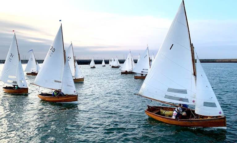 With all of Dun Laoghaire Harbour to play with, and an unusual evening onshore breeze, the Water Wag fleet takes all the tactical options on Wednesday evening. Polly (31, Roger Mossop & Henry Rooke), Badger (20, John & Anne Marie Cox) and Ethna (1, David Sommervillle & Pauline McNamara) in foreground