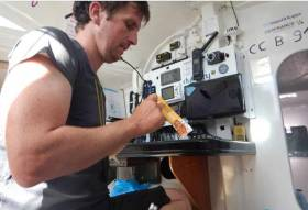 Tom Dolan enjoys a snack bar onboard Smurfit Kappa-Cerfrance as the Irish skipper approaches the Transat finish line