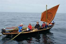 Initial venture. The Kerry currach approaching Iona with her gift of an Irish bible