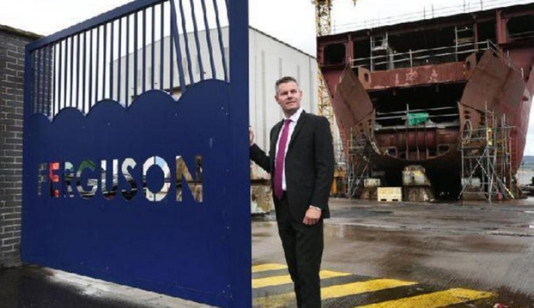 File photo: Derek Mackay the (former) Finance Secretary of Scotland AFLOAT adds pictured at the shipyard of Ferguson Marine with one of the newbuild ferry pair under construction for CalMac in Port Glasgow on the Clyde.