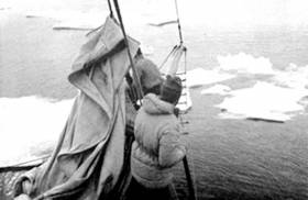 H.W. 'Bill' Tilman among loose floes on Mischief in Greenland