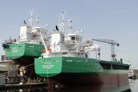 Newbuild sisters Arklow Villa the final of 10 ships for ASN sits high and dry at a Dutch yard's fit-out quay where berthed alongside is Arklow Viking which began sea trails yesterday.