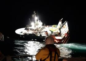 Lerwick lifeboat crew at the scene of the grounded vessel late Friday night