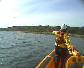 A volunteer crew member with Skerries RNLI spots a garda waving from shore