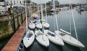 The Irish Dragon fleet moored alongside at the Royal Irish Yacht Club after the first day of the East Coast Championships on Dublin Bay