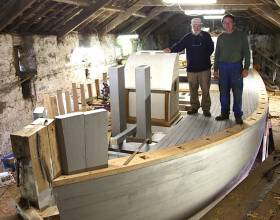 Dermot Kennedy with Liam Hegarty on the almost-completed new deck of the ketch Ilen at Oldcourt near Baltimore on Saturday