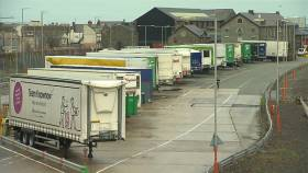 Hauliers have grave concerns over a hard Brexit, above truck trailers parked in Holyhead, north Wales.