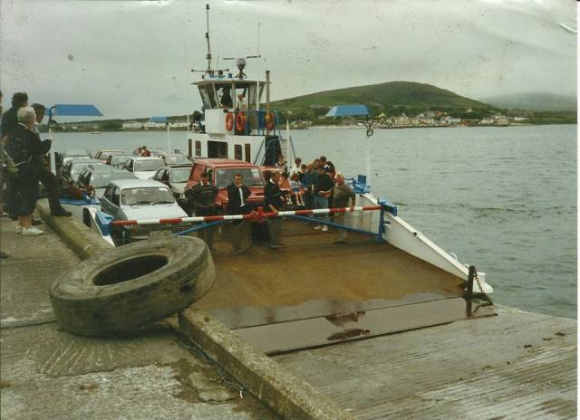 Concerns over the future of the Valentia Island car ferry service which Afloat adds is operated by the 1963 built God Met Ons III. The vessel is at Reenard Point on the inaugural day of operations in July 1996 with the backdrop of Knightstown, Valentia Island.