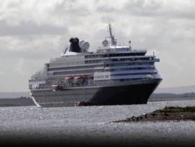 Galway City Council councillors have voted to cut a marketing grant to Galway Port used to attract liner traffic. Above Afloat adds is Holland America Lines Prinsendam at anchorage during a cruise of western seaboard ports.