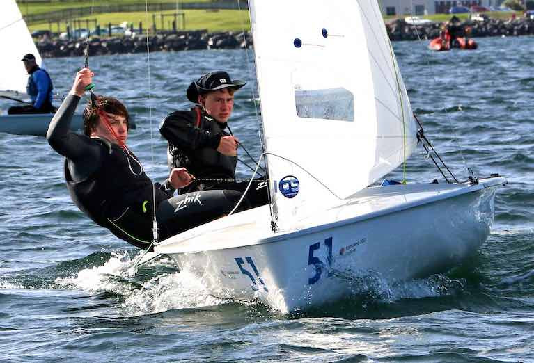 Ben Graf on helm and Alexander Farrell on wire as they shape their champion International 420 for a start