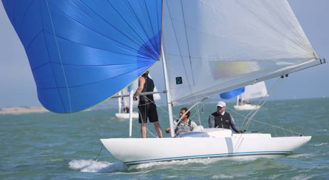 The Royal St George YC team include former winning helms, Martin Byrne pictured above at the helm of his Dragon, Jaguar.