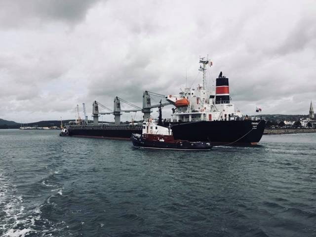 Ship Snapshot: Bulk-carrier Farania loaded with animal feed from Romania arriving with tugs, Mourne Shore (at stern) when approaching Warrenpoint Port.