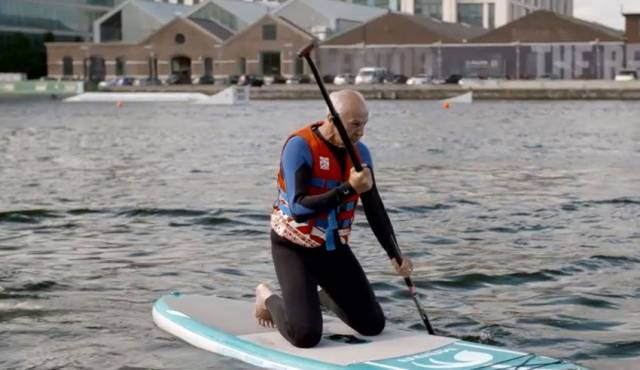 Bobby Kerr tries paddle boarding at Grand Canal Dock in the first episode of UTV Ireland's Along Home Shores